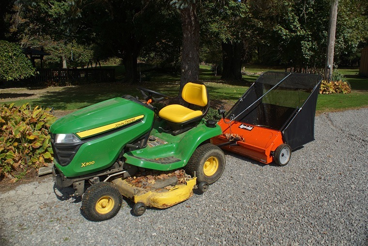 The lawn sweeper is emptied and ready for another round